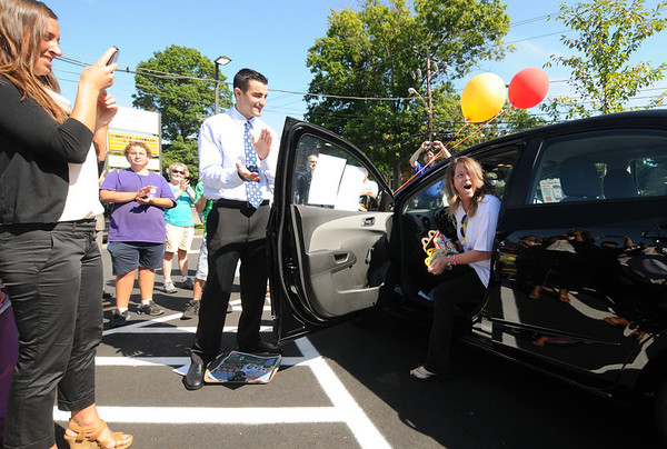 Jim Vaiknoras/Gloucester Daily Times. Linda Shoids of Gloucester reacts after winning a Chevy Sonic at the grand reopening of the Maplewood Street McDonalds in Gloucester Wednesday morning.