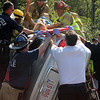 ALLEGRA BOVERMAN/Gloucester Daily Times A woman is lifted out of her vehicle by Gloucester firefighters on Thursday afternoon following a crash along Route 128 North near Exit 14. She was taken to Tufts Medical Center by helicopter for treatment.