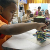 MARIA UMINSKI/Gloucester Daily Times. Six-year-old Frankie Zorilla of Gloucester begins a new structure of crayons and glue at the Art Haven in Gloucester.