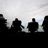 Jim Vaiknoras/Gloucester Daily Times: <br /> Fans under watch the ITL baseball finals between Manchester and Ipswich under darkening skies at memorial Field in Essex Wednesday night.