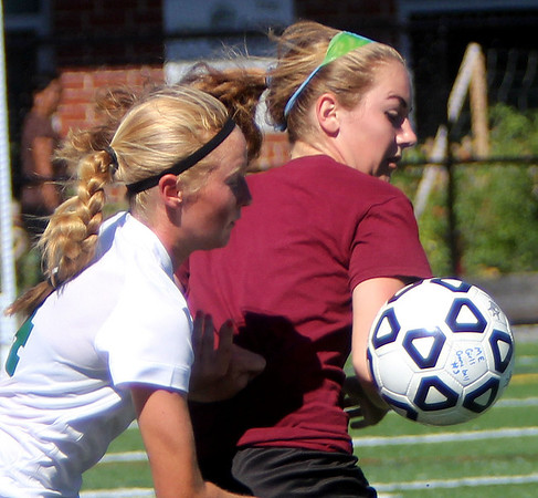 ALLEGRA BOVERMAN/Gloucester Daily Times Manchester-Essex's Olivia Lantz, left, and Gloucester's Laura Johnson in action during their scrimmage against Gloucester High School on Wednesday afternoon in Manchester. Gloucester beat M-E 2-1 in overtime.