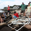 MARIA UMINSKI/Gloucester Daily Times. Counselors and New England Aquarium researchers Jeff Robinson and Anita Metzler review with their  New England Aquarium Day Camp campers the protocal for collecting their data before they begin their study. The campers were at the Eastern Point Yacht Club in Gloucester to study the diversity of marine life in rocky intertidal zones of New England for the Census of Marine Life.
