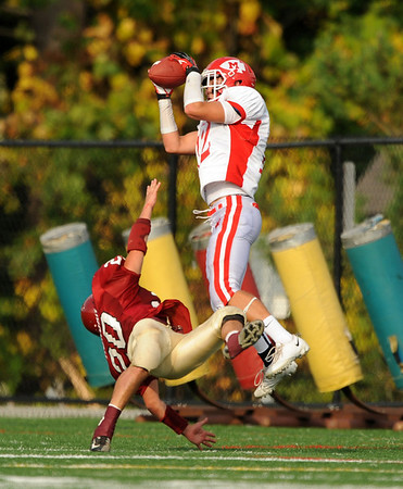 Manchester: Masconomet's Michael Guglieimi catches a pass while being coverd by Gloucester's Mark Horgan Saturday afternoon at Hyland Field in Manchester by the Sea. The play ruled that catch was out of bounds.<br /> Desi Smith/Gloucester Daily Times. October 6, 2012