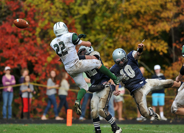 Hamilton-Wenham: Manchester's John Beardsley is hit by Hamilton-Wenham's Trevvor Lyons down near the end zone while going up for a pass from QB Cory Burnham, Saturday at Hamilton-Wenham High School.Desi Smith/Gloucester Daily Times. October 20,2012.