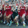 MIKE SPRINGER/Gloucester Daily Times<br /> Fiona Davis, a junior with the Manchester Essex Hornets, is surrounded by Masconomet runners at the start of a cross country match Friday at Gordon College in Wenham. Davis won the race handily, setting a new course record of 18:10.