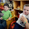 "MIKE SPRINGER/Gloucester Daily Times<br /> Michael Smith, right, and Mohammad Malik take a close-up look at Paisley the pig during a special visit Thursday at the pre-school at Fuller Elementary School in Gloucester. Paisley is a five-month-old ""micro-mini"" pig who was brought in by its owner, Karin O'Donnell of Gloucester, as part of the ""Farm Week"" festivities at the pre-school."