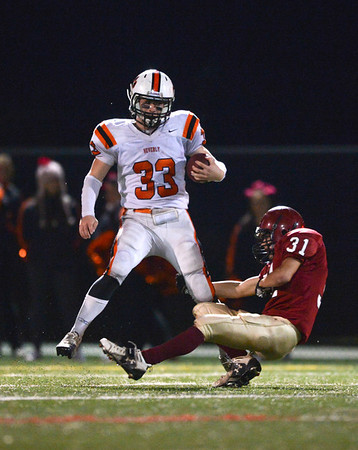 Manchester: Beverly's Brandan Flaherty doesn't seem bothered that he has Gloucester's Conor Harris trying to take him down in their match up Saturday night at Hyland Feild.  Desi Smith/Gloucester Daily Times. October 27,2012.
