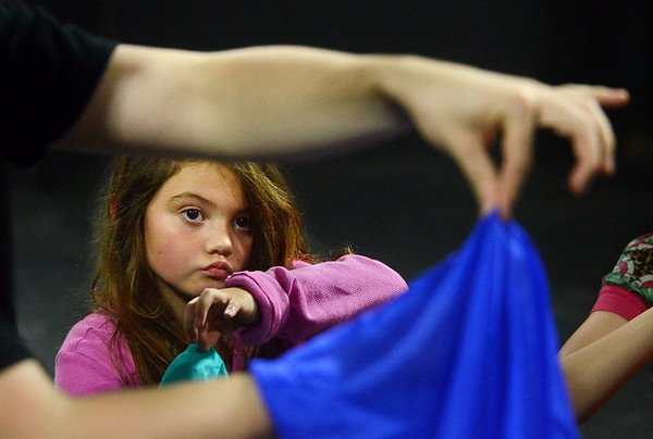 "MIKE SPRINGER/Gloucester Daily Times<br /> Six-year-old Rowan Trainor of Gloucester watches as magician Evan Northrup of Brookline teaches a slight-of-hand trick Saturday during a Gloucester Stage Youth Acting Workshop. The students are learning magic tricks to add to the Youth Acting Workshops' annual production of ""Holiday Delights,"" from Dec. 13 through Dec. 16 at the Gloucester Stage Company."