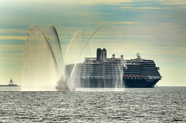 """Gloucester: The Massachusetts Port Authority """"American United"""" gives the tourist aboard the cruiseliner and the people on shore a water show, as it heads into Gloucester Harbor for an inspection Tuesday morning.      <br /> Desi Smith/Gloucester Daily Times. October 2, 2012"""