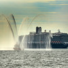 "Gloucester: The Massachusetts Port Authority ""American United"" gives the tourist aboard the cruiseliner and the people on shore a water show, as it heads into Gloucester Harbor for an inspection Tuesday morning.      <br /> Desi Smith/Gloucester Daily Times. October 2, 2012"