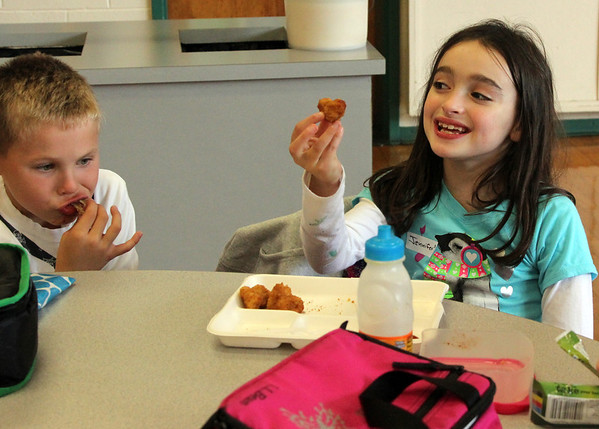 Allegra Boverman/Gloucester Daily Times. From left: Essex Elementary School second graders Gavin Kempskie and Jennifer Baker sat together at lunch on Tuesday during Mix-It-Up Lunch at the school. The National day<br /> encourages pupils to be seated at tables with children they don't normally sit with and some special guests visited to sit with them.