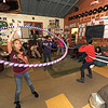 Rockport:  Teens participate in a hula hoop contest at the Rockport Teen Center at Friday nights Midnight Madness. Activities included a cookout, dance contest, capture the flag, scavenger hunt, and other fun activities. The hula hoops were made by hand and wraped in bright colors.  Desi Smith/Gloucester Daily Times. September 28, 2012