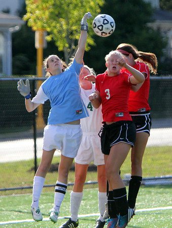 Allegra Boverman/Gloucester Daily Times Manchester-Essex goalie Ella Silag Stearns, far left, deflects a corner kick during their game against Marblehead in Manchester on Tuesday afternoon. Behind her is teammate Olivia Lantz, at right is Marblehead player Audrey Meakin.