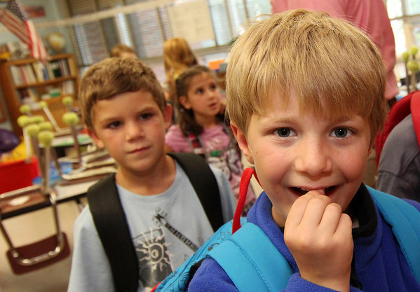 Allegra Boverman/Gloucester Daily Times On the first day of school Thursday at Essex Elementary School, Noah Foss, right, a second grader, shows off his loose tooth. Looking on at left is Cameron Sheahan. They are in Andrew Burnett's second grade class.