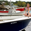 ALLEGRA BOVERMAN/Gloucester Daily Times Heidi Burgess of Manchester and Boston on Rock On, her family's tuna fishing skiff.