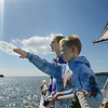 Mike Springer/Gloucester Daily Times<br /> Plum Cove Elementary School fifth graders Connor Vittands, foreground, and Emily Ross look out over Gloucester Harbor from the schooner Thomas. E. Lannon Thursday, Sept. 27, 2012 in Gloucester. The students in Grace Scola's class were on a traditional fall field trip that began at the Cape Ann Museum and ended with a cruise on the Lannon.