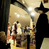 "Jim Vaiknoras/Gloucester Daily Times. <br /> ""I love photographing theater. The lighting is generally good and the actors are naturally expressive. When I photographed the Annisquam Village Players production of ""The Wizard of Oz,"" my attention fell immediately upon Gina Milne, who played the Wicked Witch of the West. She was moving around backstage assisting all the kids with their costumes, hair and makeup, basically being a helpful mom. Then she stepped onstage, and she transformed into an evil witch. What I love about this photo is that it shows both sides: a wonderful telling glimpse of the line between the real and the imagined."""