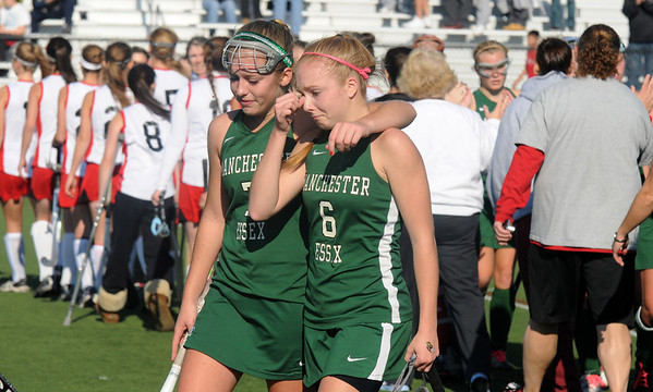 Jim Vaiknoras/Gloucester Times. Manchester Essex player Megan Jones consoles teammate Nicole Bradley after their 2-0 loss to Watertown in the  Division 2 North Sectional Championship Game at North Andover high school.