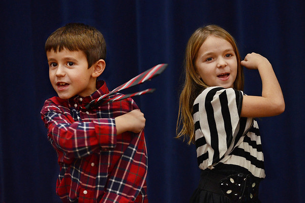 "MIKE SPRINGER/Gloucester Daily Times<br /> ""Children are interesting to photograph because of their ingenuousness and vitality. In this situation, second graders Brian Kelly, Jr. and Kaitlin Harding were singing a sea shanty during a Holiday concert at Essex Elementary School. Certain Popeye-like arm gestures were called for, and Brian and Kaitlin were up to the task."""