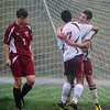 "Desi Smith/Gloucester Daily Times. Rockport: Rockport's Kyle Hurst is congratulated by teammate Nick Laverde after netting a goal against Newburyport, as a dejected Brendan Byron walks away during their game in October at Rockport High School. <br /> <br /> ""I love the reaction of the player after he scored a goal and the dejection of the defender while they played in the rain and mud."""