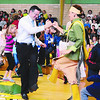 "Jim Vaiknoras/Gloucester Daily Times. <br /> ""One of the best parts of my job is taking photos in the elementary schools. The kids are so expressive. Even when involved in what might seem like a mundane task, they bring a joy and exuberance that is, unfortunately, lessened as they get older.  When I visited Manchester Memorial Elementary School to cover a performance by Wampanoag Singers and Dancers, however, that notion flew out the window as dancer Danielle Hill and school Principal John Willis joined pinky fingers and performed the mosquito dance with the energy and joy of a first-grader."""