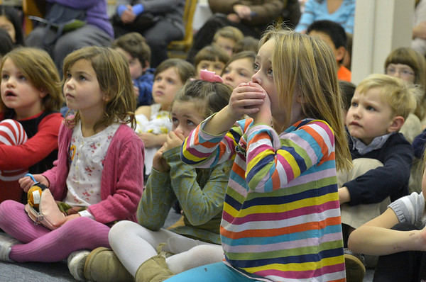 """Desi Smith/Gloucester Daily Times. Essex: Ava Fritsch 6, of Essex, reacts while listening to """"The Nutcracker""""  being read by Storyteller Carolyn Martino at the Essex Public Library in early December.  <br /> <br /> """"I love the looks on the young children's faces in this image, especially the girl on the right as she gasped at the reading of a scary moment during a telling of the story of 'The Nutcracker.' """""""
