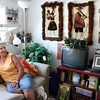 "MARIA UMINSKI/Gloucester Daily Times. Resident Mary Ann Camp relaxes in her home at Rockport High School Apartments in August.<br /> <br /> ""The one thing I loved about taking pictures of the residents who live in the Rockport High School Apartments was not only seeing their lovely living spaces but hearing their stories. Whether they had lived in Rockport all their lives and attended school in that very building or if they had moved there, it all fascinated me. Also the fact that it was once a high school is still pretty cool to me."""