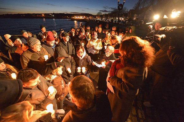 """Desi Smith/Gloucester Daily Times. Gloucester: Family and friends gathered for a vigil for the crew of Foxy Lady II, Wallace """"Chubby"""" Gray, Jr. and Wayne Young in late December at the Man at the Wheel statue on Stacy Boulevard."""