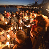 "Desi Smith/Gloucester Daily Times. Gloucester: Family and friends gathered for a vigil for the crew of Foxy Lady II, Wallace ""Chubby"" Gray, Jr. and Wayne Young in late December at the Man at the Wheel statue on Stacy Boulevard."
