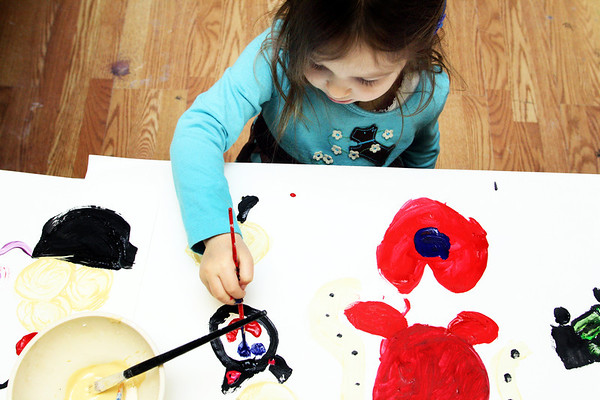 Jesse Poole/Gloucester Daily Times. After finishing a red and blue heart, Talia Conlon, 5, moves on to paint a cat at Art Haven in Gloucester during the Paint Big event, at which children helped paint giant canvases in late February.
