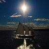 "Jim Vaiknoras/Gloucester Daily Times. <br /> ""It's easy to forget that we didn't always have cellphones, but without one, I don't think I would have been able to coordinate this summer shoot with the crew of the schooner Thomas E. Lannan. The plan was for me to be positioned at the end of the breakwater at Eastern Point and photograph her as she sailed around the harbor at sunset. Driving to get there through Gloucester, though, I ran into some traffic and got there a few minutes too late. Or so I thought. I shot a few good photos, but was a little disappointed that I didn't get exactly what I wanted. Then my cellphone rang. It was the captain of the Lannan asking if I wanted him to make another pass by me. I got better photos than I could have hoped for. As I was leaving, a couple who had seen me jogging down the breakwater to catch up with the boat said, ""Lucky break, them turning around."" I pulled out my phone and told them it wasn't lucky at all."""