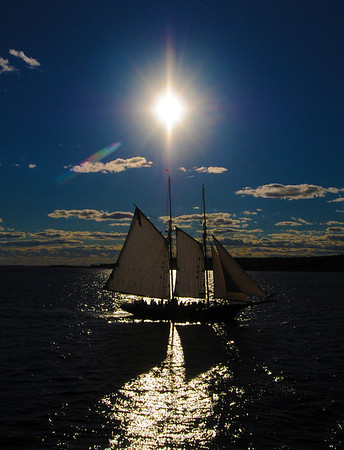 """Jim Vaiknoras/Gloucester Daily Times. <br /> """"It's easy to forget that we didn't always have cellphones, but without one, I don't think I would have been able to coordinate this summer shoot with the crew of the schooner Thomas E. Lannan. The plan was for me to be positioned at the end of the breakwater at Eastern Point and photograph her as she sailed around the harbor at sunset. Driving to get there through Gloucester, though, I ran into some traffic and got there a few minutes too late. Or so I thought. I shot a few good photos, but was a little disappointed that I didn't get exactly what I wanted. Then my cellphone rang. It was the captain of the Lannan asking if I wanted him to make another pass by me. I got better photos than I could have hoped for. As I was leaving, a couple who had seen me jogging down the breakwater to catch up with the boat said, """"Lucky break, them turning around."""" I pulled out my phone and told them it wasn't lucky at all."""""""