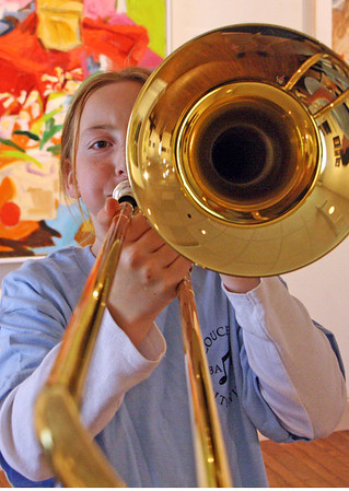 Jesse Poole/Gloucester Daily Times. Jemima Grow, 10, practices on the trombone at the Cape Ann Museum in May during the Gloucester Public School Arts Festival.
