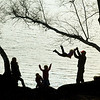 "MIKE SPRINGER/Gloucester Daily Times<br /> ""Sometimes its nice to stand back at a distance and watch as things unfold. This family--Tim and Csilla Clark and their three children, Forrester, Kata and Natalia--was enjoying an early November afternoon together on the shore of Chebacco Lake, in Essex."""