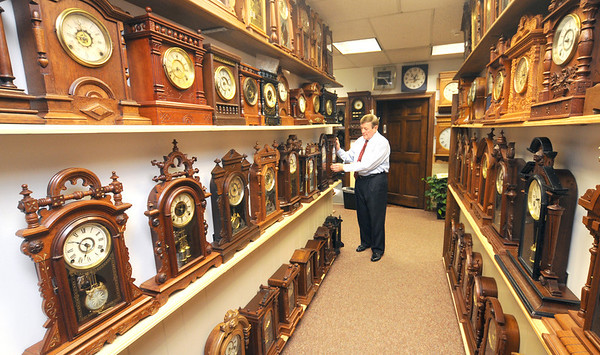 """Jim Vaiknoras/Gloucester Daily Times<br /> """"I don't own a watch, never did. I usually rely on other ways to tell time: my phone, car clock or a bank. Some people keep time close; people like Howard Frisch keep time even closer. With over 800 clocks in his Gloucester office, time is everywhere you look. Photographing him posed an interesting challenge: how to capture the scale of the clocks and his love and appreciation of his timepieces. If time is money, he is indeed a wealthy man."""""""