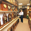 "Jim Vaiknoras/Gloucester Daily Times<br /> ""I don't own a watch, never did. I usually rely on other ways to tell time: my phone, car clock or a bank. Some people keep time close; people like Howard Frisch keep time even closer. With over 800 clocks in his Gloucester office, time is everywhere you look. Photographing him posed an interesting challenge: how to capture the scale of the clocks and his love and appreciation of his timepieces. If time is money, he is indeed a wealthy man."""