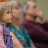 Miriam West, 2, of Lunenburg, looks a little unsure as she listens to The Gloucester Hornpipe & Clog Society at the Lunenburg Public Library. SENTINEL&ENTERPRISE/ Jim Marabello