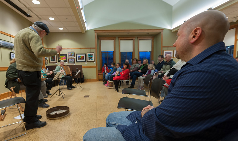 David Rosen of The Gloucester Hornpipe & Clog Society plays the bones during a concert at the Lunenburg Public Library.  SENTINEL&ENTERPRISE/ Jim Marabello