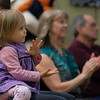 Miriam West, 2, of Lunenburg, on the lap of her father David, applauds after  listening to The Gloucester Hornpipe & Clog Society at the Lunenburg Public Library. SENTINEL&ENTERPRISE/ Jim Marabello