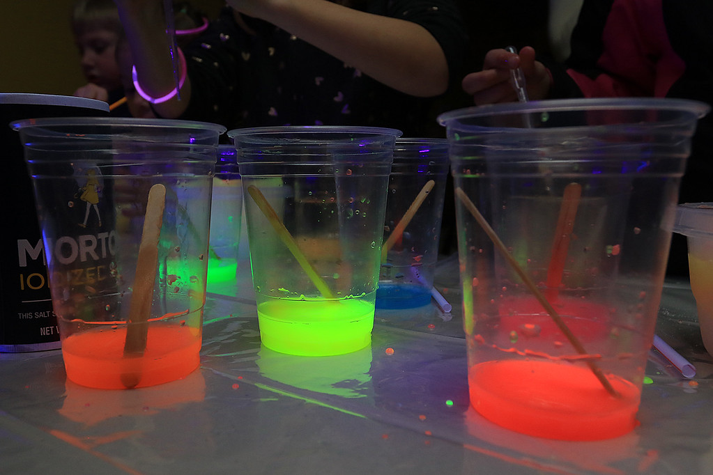 . Stevens Memorial Library held a Glow Party on Wednesday night in their Activity Room for kids 5-12. The kids mixed baby oil with glow in the dark paint and water during the event. SENTINEL & ENTERPRISE/JOHN LOVE
