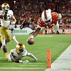 Nov 11, 2017; Miami Gardens, FL, USA; Miami Hurricanes quarterback DeeJay Dallas (13) dives over for a touchdown past Notre Dame Fighting Irish safety Jalen Elliott (21) during the second half against at Hard Rock Stadium. Mandatory Credit: Steve Mitchell-USA TODAY Sports