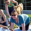 Giving Yoga instruction is Olivia Evans (standing), to Cheryl Prentiss with a goat on her back, and looking on on left is Chelsea Hudson of Lunenburg. SUN/ David H. Brow