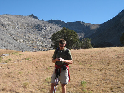 I check our progress as we enter the alpine basin. [Terry Patterson photo]