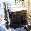 (8 of 10) Solar Stock Tank Opening<br /> At the North-east end I have the opening for the goats and donkey to stick their heads in and get a drink. I have strips of rubber hanging down over the opening to keep from losing the heat inside yet let them put there heads in easy. Putting water in, in the morning also helps to warm it inside.