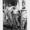 P00100 Two sailors in work uniform standing on main deck starboard