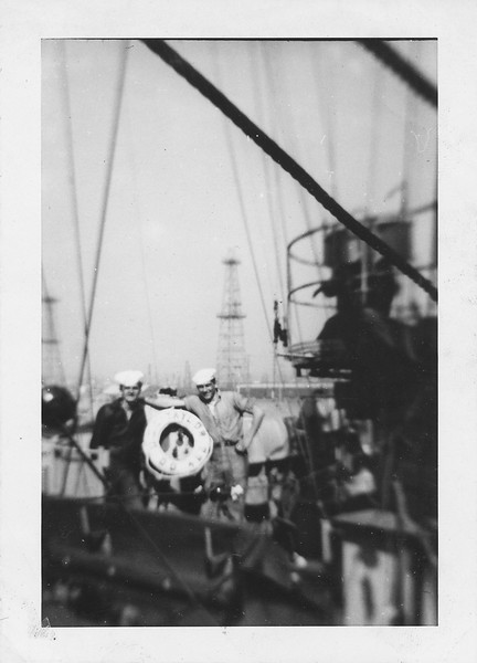 P00121 Two sailors on bridge wing with life ring