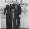 P00055 Two sailors in dress blues posing in front of battleship backdrop (Long Beach? postcard) EDGAR