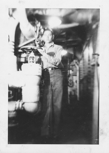 P00127 Sailor in work uniform in Main Engine Room with valve
