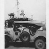 P00104 Chief (?) in Japanese staff car (?) on dock, probably Tokyo, 1945
