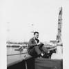 P00086 Sailor in work uniform sitting on rail